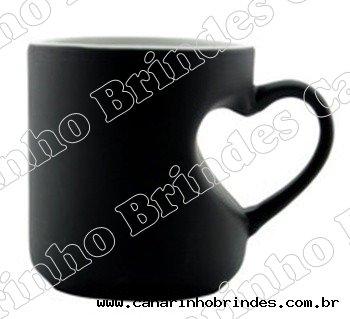 http://www.canarinhobrindes.com.br/content/interfaces/cms/userfiles/produtos/caneca-de-ceramica-magica-preta-com-coracao-interno-219.jpg